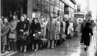 Shoppers queuing to enter the summer clearance sale at the Plummer Rodis department store in July 1947. This store subsequently became Debenhams until 1998. | Image reproduced with kind permission from Brighton and Hove in Pictures by Brighton and Hove City Council