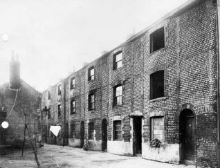 Flint and Cobble Buildings , c. 1910; A row of houses in the Carlton Hill area, built in c.1790 of flint and cobble-stones. These were probably demolished in the 1930s as part of Brighton Borough Council's ambitious slum-clearance programme. | Image reproduced with kind permission from Brighton and Hove in Pictures by Brighton and Hove City Council