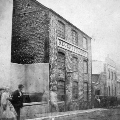 Regent Iron Foundry, c. 1890: The Regent Iron Foundry was on the corner of North Road and Foundry Street from about 1800 until 1912. At its peak over 100 workers were employed making many of the iron railings, drain covers and parts for railway bridges and piers in Brighton. The site is now occupied by the Royal Mail sorting office. | Image reproduced with kind permission from Brighton and Hove in Pictures by Brighton and Hove City Council
