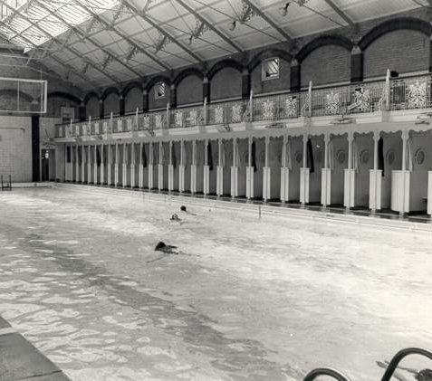 Swimmers at North Road Baths, 9 May 1978: The pool measured 120 by 33 feet. It closed in November 1979 and the Prince Regent Swimming Pool was built on the site. An arched entrance from North Road formerly leading to the baths remains. | Image reproduced with kind permission from Brighton and Hove in Pictures by Brighton and Hove City Council