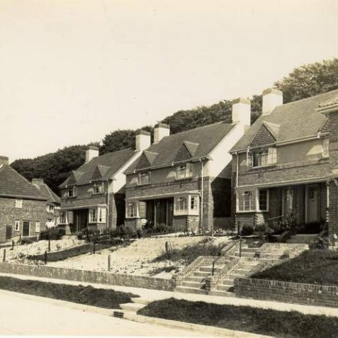 Houses in East Moulsecoomb, July 1937: A row of semi-detached houses in East Moulsecoomb, which was built between 1935-36. Recently built, these houses are numbered 4 to 22, with front gardens at varying stages of growth. | Image reproduced with kind permission from Brighton and Hove in Pictures by Brighton and Hove City Council
