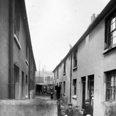 Five Children in Oxford Court, 1935: This cul-de-sac off Oxford Street included 14 cottages, stables, and stores for shops on Oxford Street and London Road. Known as