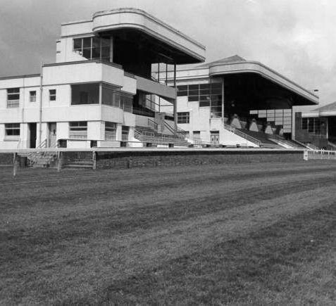 Race Stands at Brighton Racecourse, c. 1960s: These three stands were built between 1934 and 1938. On the left is the Club Stand which was built in Art Deco style by Yates, Cook and Derbyshire of London. All of these stands were removed after a new grandstand opened in May 1965. | Image reproduced with kind permission from Brighton and Hove in Pictures by Brighton and Hove City Council