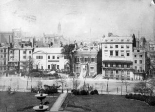 Buildings on West Side of the Old Steine, c. 1890: Marlborough House built in 1765 is the oldest remaining house on the Steine, and gained its name when owned by the fourth Duke of Marlborough between 1771 and 1786. In this photograph it was then the Brighton Board School Office. Steine House, built in 1804 for Maria Fitzherbert, is now a YMCA hostel. Blenheim House was then The Albany School for Girls. Victoria Fountain, supported by three entwined dolphins on a base of sarsen stones was installed at the centre of the Steine by Amon Henry Wilds in 1846 | Image reproduced with kind permission from Brighton and Hove in Pictures by Brighton and Hove City Council