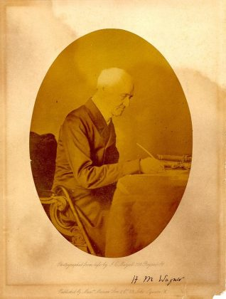 Reverend Henry Wagner was Vicar of Brighton from 1824 until his death in 1870. Born in 1792, he had 6 churches built to enable the poor of Brighton to attend services, of which St John the Evangelist and St. Paul's survive. In this photograph, Wagner is seated at a desk, pen in hand. | Image reproduced with kind permission from Brighton and Hove in Pictures by Brighton and Hove City Council