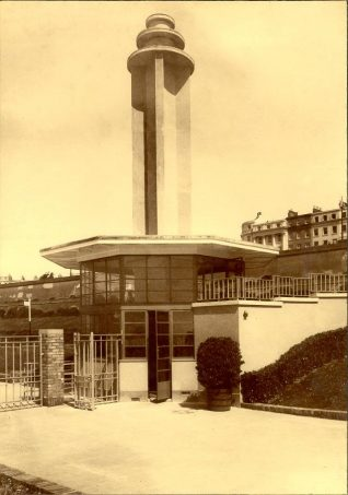 Entrance to Black Rock Swimming Pool, August 1937. Entrance to Black Rock Swimming Pool as seen from within the complex, showing the prominent tower. The discs at its summit were illuminated by neon tubes. On the opposite side of the tower was an illuminated neon sign of a woman in swimwear. Black Rock Swimming Pool opened on 8 August 1936 and measured 165 feet by 60 feet. It was designed by the Borough Engineer David Edwards in
