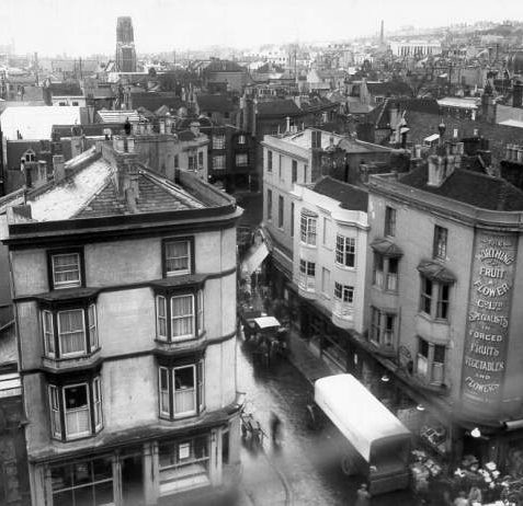 Prince Albert Street Looking West, 16 October 1930: A view of Prince Albert Street showing the shopfront of the Worthing Fruit and Flower Company. This photograph was taken from the roof of Brighton Town Hall. | Image reproduced with kind permission from Brighton and Hove in Pictures by Brighton and Hove City Council