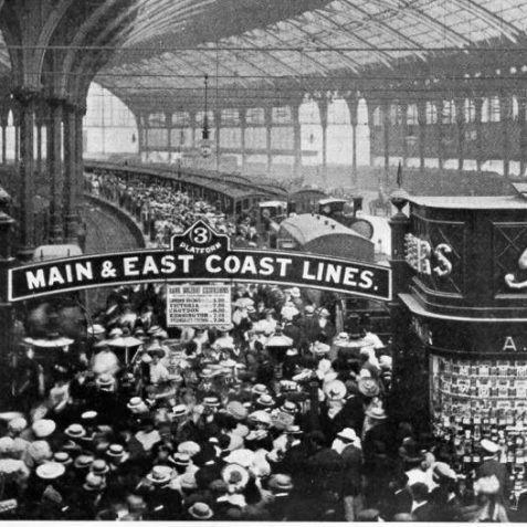 Passengers at Brighton Station, c. 1905. A crowd of passengers on Platform 3 at Brighton Station. A sign hanging from the overhead platform sign advertises times of return trains to different parts of London. It is likely that these passengers are making their return journey home after a bank holiday excursion to Brighton. | Image reproduced with kind permission from Brighton and Hove in Pictures by Brighton and Hove City Council