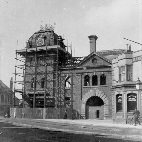 Demolition of Amber Ale Brewery, 1901: Longhurst's Amber Ale Brewery was built in 1881 for the Stanford Estate trustees by H. J. Lanchester, next to the Hare and Hounds public house. The brewery was later taken over by the Fry mineral water company and was demolished in 1901 to enable enough space for tram lines to turn from Beaconsfield Road into Viaduct Road. The site of the brewery is now occupied by the Fire Station. The Hare and Hounds was rebuilt in 1905. | Image reproduced with kind permission from Brighton and Hove in Pictures by Brighton and Hove City Council