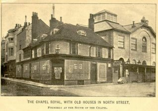 Chapel Royal, c. 1876: The Chapel Royal was built in 1793-5 by Thomas Saunders for Revd Thomas Hudson, Vicar of Brighton and became a chapel of ease to St Nicholas' Church in 1803. Above the chapel there is a Coade stone coat of arms, which remains. This photograph shows the chapel before it was extensively rebuilt in 1876-82 by Sir Arthur Blomfield. The buildings on the left are about to be demolished to enable North Street to be widened. The current clock tower and new entrances were added in 1882. The glazed lantern was designed by G. Lynn of Brighton and added in 1848. | Image reproduced with kind permission from Brighton and Hove in Pictures by Brighton and Hove City Council