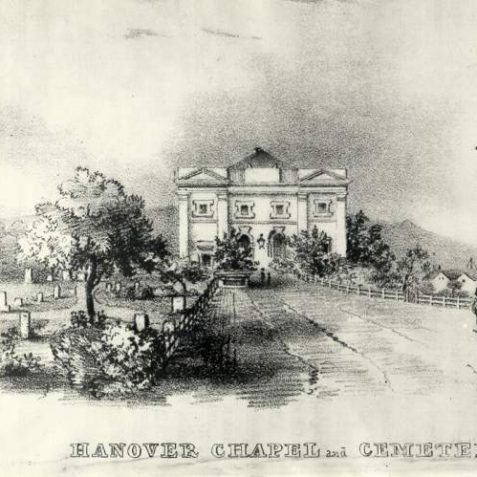 Hanover Chapel and Cemetery, c. 1840: Built in 1825 as an independent chapel for the Revd M. Edwards, and used by the Presbyterian Church from 1844. In 1845 Queen's Road was built over the western edge of the burial ground, but the cemetery's boundary wall and railings remain on the western side of Queen's Road as a raised pavement. In 1949 the churchyard was laid out as the Queen's Road Rest Garden, with the gravestones being removed to line the perimeter walls. | Image reproduced with kind permission from Brighton and Hove in Pictures by Brighton and Hove City Council
