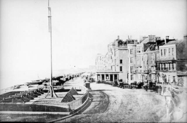 West Battery, c. 1850. The West Battery consisted of six cannons on King's Road, installed in 1793. These muzzle-loaded cannons could fire a cannon-ball of about 40 pounds in weight, but were never fired in military defence. Behind the Battery was a crescent of houses called Artillery Place, which housed the Royal Navy Lieutenant in charge. These were replaced by the Grand Hotel in 1864. On 27 January 1858 the West Battery was removed in order for King's Road to be widened. The Battery is now marked by a flagpole on the beach. | Image reproduced with kind permission from Brighton and Hove in Pictures by Brighton and Hove City Council
