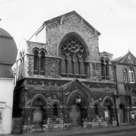 Lewes Road United Reformed Church, 1975: Lewes Road United Reformed Church, on the west side of Lewes Road, was built as a Congregational chapel in 1878 by A. Harford in Italian Gothic style. To its right there is a church hall built in 1892. | Image reproduced with kind permission from Brighton and Hove in Pictures by Brighton and Hove City Council