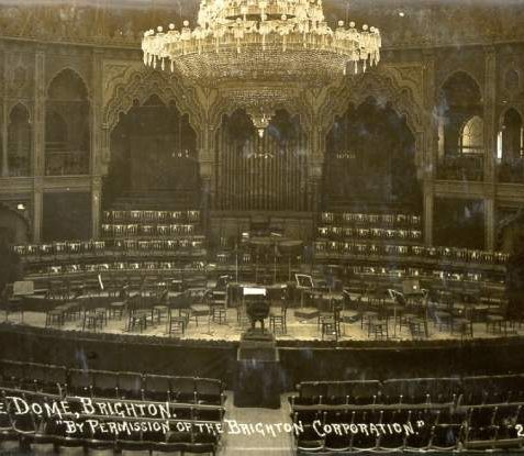 Auditorium of the Dome, c. 1910: After conversion to the Moorish designs of the Borough Surveyor Philip Lockwood, the Dome reopened on 24 June 1867 as a concert hall seating 2,500 people with a gas chandelier measuring 30 feet high and 16 feet across. This photograph was taken prior to the 1934-5 refurbishment. | Image reproduced with kind permission from Brighton and Hove in Pictures by Brighton and Hove City Council