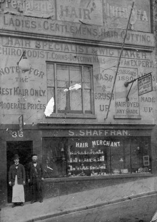 Shopfront of S. Shaffran, hair merchant at No. 36 Church Street, offering services including hair-dyeing, chiropody and wig-making.