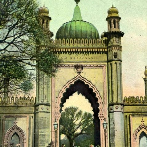 North Gate to Royal Pavilion, c. 1907: The North Gate, the northern entrance to the Royal Pavilion, is an Indian style gateway of Portland stone, surmounted by a copper dome and flanked by 2 lodges. It was erected by Joseph Good in 1832 for King William IV, and is adorned with pillars and minarets. | Image reproduced with kind permission from Brighton and Hove in Pictures by Brighton and Hove City Council