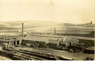 Engine Sheds at Brighton Station., 1868: Aerial view of trains and engine sheds at Brighton Station. The New England Hill viaduct can be seen on the left, a windmill to the right. Little development of Brighton has yet taken place in this photograph.   Image reproduced with kind permission from Brighton and Hove in Pictures by Brighton and Hove City Council