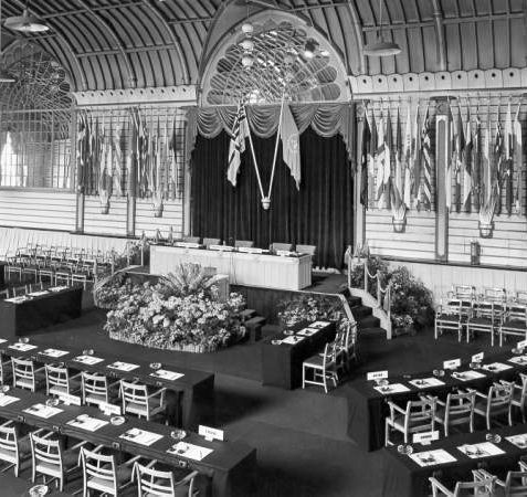Conference at Corn Exchange, 1953: In this photograph an international conference of the United Nations is being held. Each place along the tables was provided with a headset through which simultaneous translations of the discussion could be heard. | Image reproduced with kind permission from Brighton and Hove in Pictures by Brighton and Hove City Council