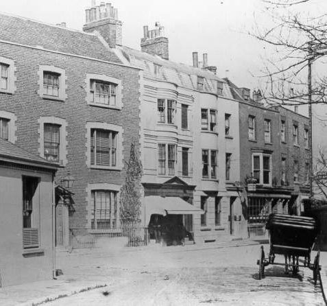 Ship Street and Prince Albert Street, 1872: This photograph shows an attractive group of late 18th and early 19th-century houses. There are wooden slatted Venetian blinds in the windows of the cobbled house on the left. These houses still survive, but they have been altered. The building on the far left of this picture has been replaced | Image reproduced with kind permission from Brighton and Hove in Pictures by Brighton and Hove City Council