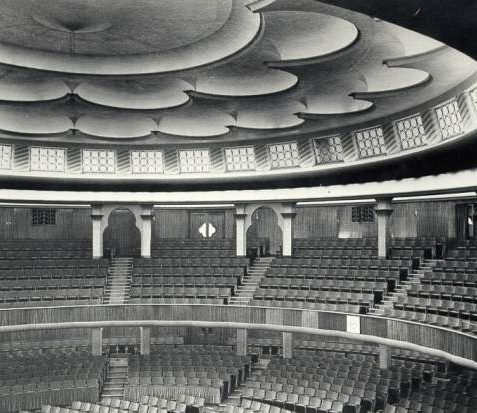 Interior of the Dome, c. 1935: In 1934-5 the Dome interior was redesigned by Robert Atkinson at a cost of £50,000 to give a total of 2,100 seats. An interior ceiling, electric organ and a new balcony were added. The Dome was reopened by the mayor, Sidney Gibson, on 14 September 1935. | Image reproduced with kind permission from Brighton and Hove in Pictures by Brighton and Hove City Council