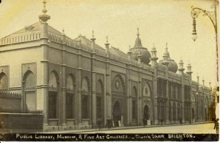 Public Library, Museum and Art Gallery, Church Street, c. 1905: The Library entrance on the right was added in 1902 when the Victoria Public Library opened within the building. The arched entrance under the clock led directly into the large central hall of the Museum and Art Gallery. The entrance to the Art Gallery and Museum continued to be used until about 1910, when it was bricked up to form a window, requiring the use of the library entrance. | Image reproduced with kind permission from Brighton and Hove in Pictures by Brighton and Hove City Council