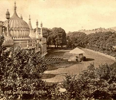 Royal Pavilion and Gardens, c. 1914: A bandstand and chairs are arranged on the eastern lawns of the Royal Pavilion. The lawns were subsequently levelled in 1921-23, and small ornamental pools, tropical ferns and a miniature balustrade were then added. | Image reproduced with kind permission from Brighton and Hove in Pictures by Brighton and Hove City Council