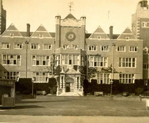 Roedean School, c. 1910: The main building has large gables and a clock tower, with a 500 foot frontage. Four protruding bays contain the boarding houses. | Image reproduced with kind permission from Brighton and Hove in Pictures by Brighton and Hove City Council