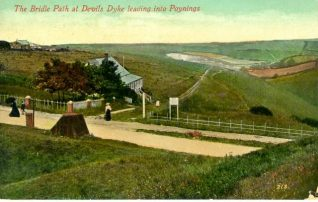 Bridle Path at Devil's Dyke Leading into Poynings, c. 1905: Devil's Dyke is a deep valley 5 miles north-west of Brighton, crowned by an Iron Age hill fort. The area has been a popular destination for visitors from Brighton and Hove since at least the early nineteenth century, and there has been a succession of hotels there since 1831. This view shows a bridleway leading to Poynings, a village in whose parish Devils Dyke lies. | Image reproduced with kind permission from Brighton and Hove in Pictures by Brighton and Hove City Council