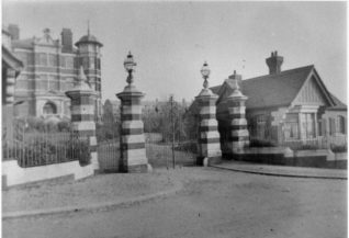 Entrance and Gatehouse at Brighton Borough Hospital, c. 1900: Bevendean Hospital originally opened in 1881 as a smallpox sanatorium. The main buildings were erected in 1898, and the institution became the Brighton Borough Hospital, specialising in treating people with tuberculosis and other infectious diseases until it was taken over by the National Health Service in 1948. It then became Bevendean Hospital, and continued to treat patients until April 1989. Most of the buildings have been demolished and a housing estate has been built on much of the site. The Sussex Beacon hospice and continuing care centre for people with HIV/AIDS is also within the former hospital grounds. | Image reproduced with kind permission from Brighton and Hove in Pictures by Brighton and Hove City Council