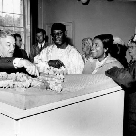 Model of Sussex University, c. 1960s: Governor General of Nigeria Dr Azikiwe and Mrs Azikiwe inspecting a scale model of the proposed University of Sussex at Stanmer House. On the left is John Fulton, Vice chancellor of the University from 1960-67. On the right is Alderman S. Caffyn. | Image reproduced with kind permission from Brighton and Hove in Pictures by Brighton and Hove City Council