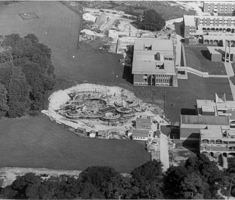 Aerial View of Sussex University campus, August 1968: This photograph shows the Gardner Arts Centre under construction. On the right, a path runs between Falmer House (lower right) and the Arts buildings (upper right), with a path leading left to the library. | Image reproduced with kind permission from Brighton and Hove in Pictures by Brighton and Hove City Council