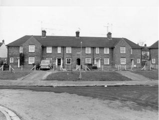 A row of four houses in Newick Road, North Moulsecoomb. This estate of 390 houses was built between 1926-30. Photograph Copyright Evening Argus. | Image reproduced with kind permission from Brighton and Hove in Pictures by Brighton and Hove City Council