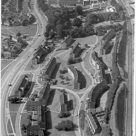 Aerial View of Moulsecoomb, August 1968: An aerial photograph of the Bates Estate and Selsfield Drive area between Lewes Road and the East Coastway Railway Line. At the top of the picture is the 10 storey Cockcroft Building, which opened as Brighton College of Technology in 1963 and merged with Brighton College of Art in April 1970 to become Brighton Polytechnic, now Brighton University. | Image reproduced with kind permission from Brighton and Hove in Pictures by Brighton and Hove City Council