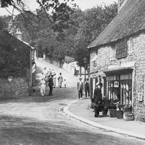 Church Hill, Patcham, c. 1910: Old London Road, Patcham, with people walking up Church Hill. On the right is the